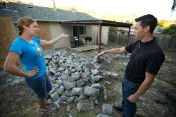 Lara Wood, left, and husband Sam Tanaka look at the construction debris in their back yard, Monday, Aug. 24, 2015 in San Leandro, Calif. When they discovered their new home had drainage issues, they decided to try to cut the repair expenses by jackhammering out an existing concrete patio and hauling it away themselves. (D. Ross Cameron/Bay Area News Group)